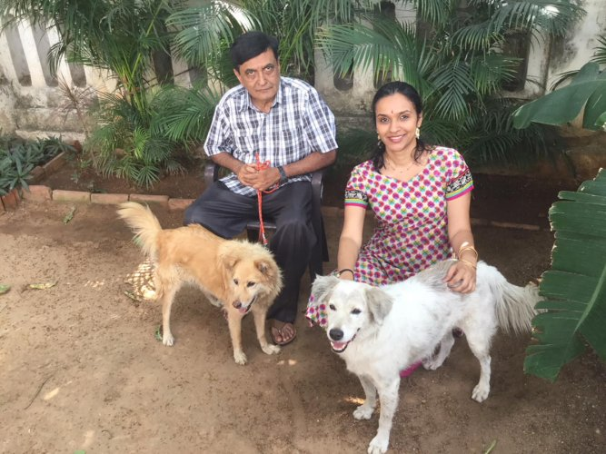 The author Madhu (right) with uncle Vijay and pets Foxy and Friendly.