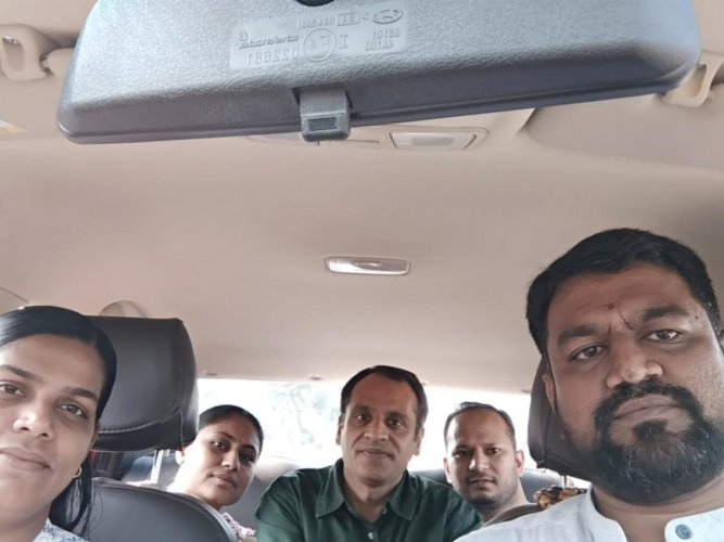 Zaheer Adhoni (right) with his carpooling group.