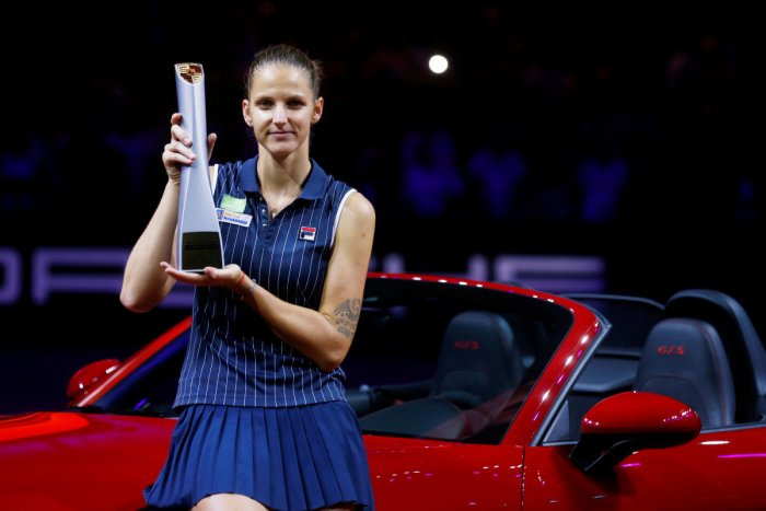 Sweet success :Czech Republic's Karolina Pliskova celebrates with the trophy after winning the final against CoCo Vandeweghe of the US on Sunday. Reuters
