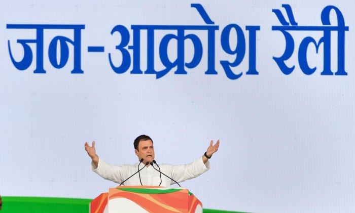 Congress President Rahul Gandhi addresses during 'Jan Akrosh Rally', in New Delhi on Sunday. PTI Photo