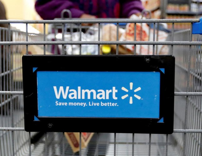A customer pushes a shopping cart at a Walmart store in Chicago, in this file photo. REUTERS