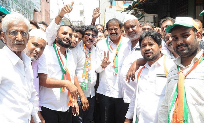 Congress candidate Akhanda Srinivasa Murty with his supporters at D G Halli ward in Bengaluru on Saturday.