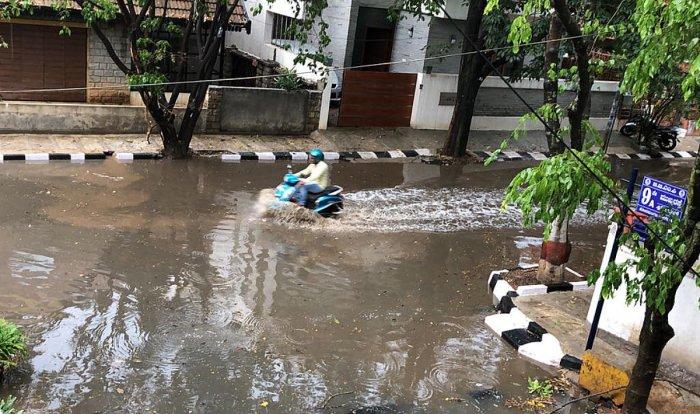 Rain water logged on Koramangala 4th block 9th a main in Bengaluru on Monday. .
