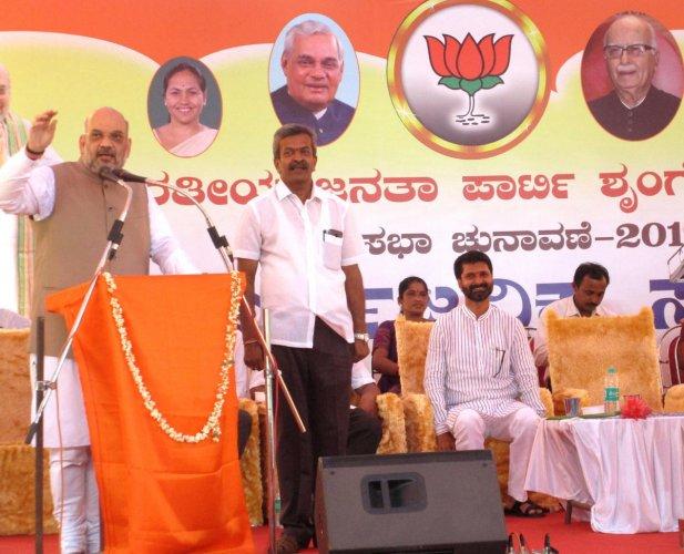 BJP National President Amit Shah addresses BJP election rally in Sringeri on Tuesday.
