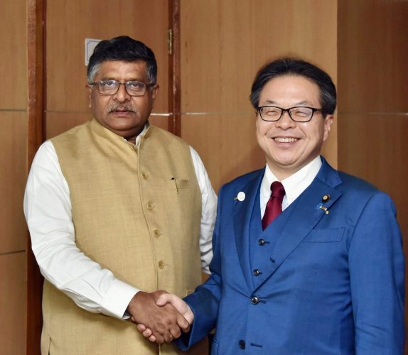 Minister of Economy Trade and Industry, Japan, Hiroshige Seko meets with the Union Minister for Electronics & Information Technology and Law & Justice, Ravi Shankar Prasad in New Delhi on Tuesday. PTI Photo