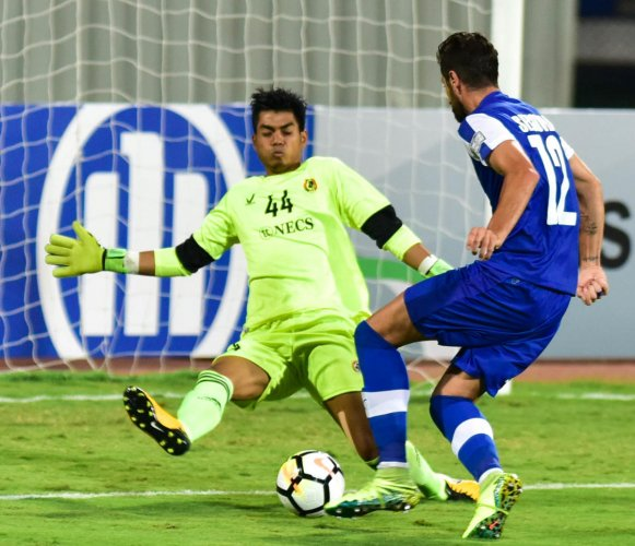 BFC's Daniel Segovia (right) tries to score past Aizawl FC goalkeeper Lalawmpuia during their clash in the AFC Cup football tournament at the Sree Kanteerava Stadium in Bengaluru on Wednesday. (DH Photo/B H Shivakumar)