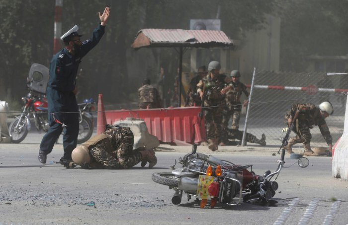 Afghan security forces are seen at the site of a second blast in Kabul, Afghanistan April 30, 2018. REUTERS