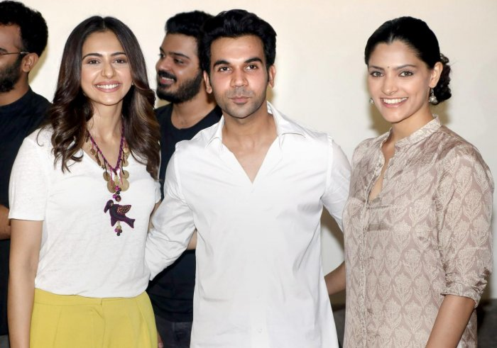 Bollywood actor Rajkummar Rao (C) with Rakul Preet Singh (L) and Saiyami Kher (R) pose for a photographer during the screening of his upcoming biographical crime drama 'Omerta' in Mumbai on Sunday. PTI Photo