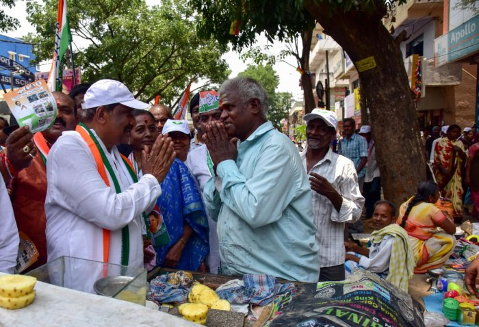 Sarvagnanagar Constituency Congress Candidate K J George seen during the Campaigning road show with his supporters, Banasawadi in Bengaluru on Monday. Photo/ B H Shivakumar
