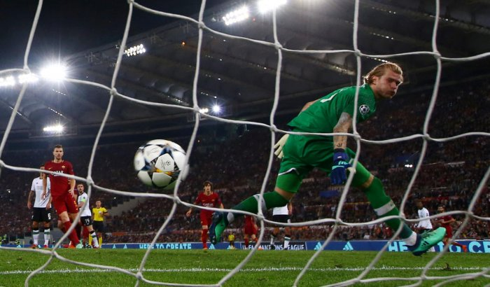 Roma's Radja Nainggolan scores their third goal as Liverpool's Loris Karius watches the ball go in the net. REUTERS Photo