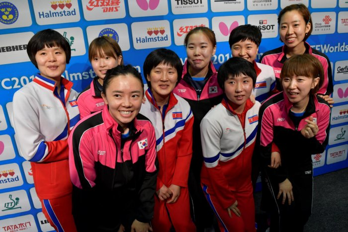 South Korean and North Korean teams pose after deciding to form a unified Korean team for the semifinals at the World Team Table Tennis Championships in Sweden on Thursday. Reuters