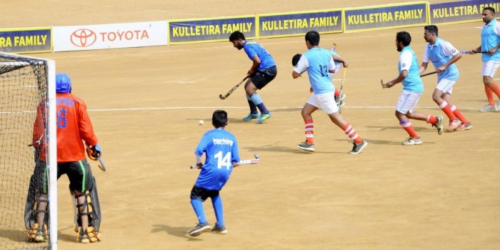 Chendrimada and Bachira teams seen in action against each other during a match in Napoklu on Thursday. DH PHOTO
