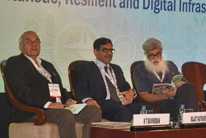 Prof K T Ravindran, Dean emeritus, RICS School of Built Environmnet New Delhi (L), Rajat Kathuria, Director and Chief Executive Indian Council for Research on International Economic Relations (ICRIER) New Delhi (C), and Partha Mukhopadhyay, Senior Fellow,