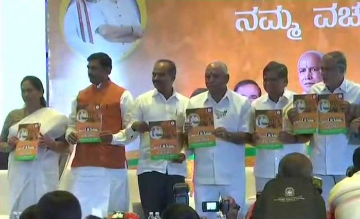 The manifesto, unveiled by BJP state unit president and the party's chief ministerial candidate, B S Yeddyurappa also said if voted to power, it would bring out a 'white paper' on the financial health of the state under the Congress rule. Image Courtesy: ANI/Twitter
