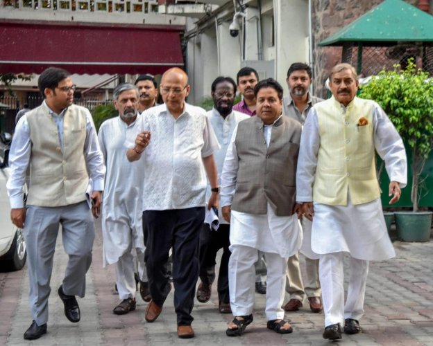 Senior Congress leaders leave after a meeting with Election Commission of India, at Nirvachan Sadan in New Delhi on Thursday. PTI Photo