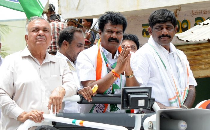 Home minister Ramalinga Reddy and member of parliment D K Suresh campaigning for Anekal assembly constituency congress candidate Shivanna at Anekal on Wednesday. Photo Srikanta Sharma R.