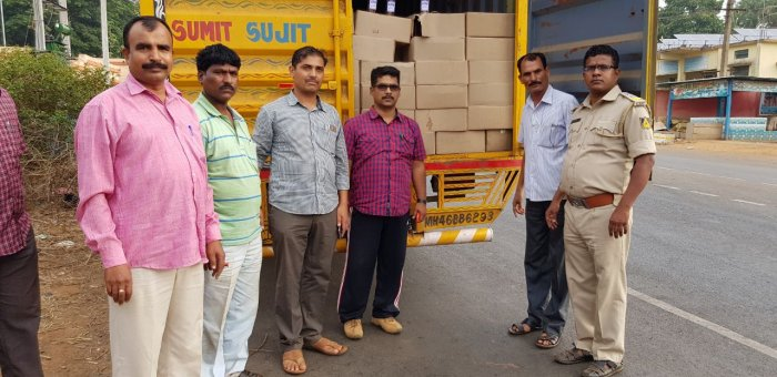 The raided truck containing liquor being transported from Goa.
