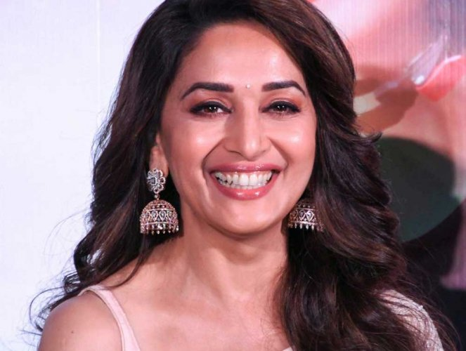 """With this film, Madhuri has again collaborated with her """"Hum Aapke Hain Koun"""" co-star Renuka Shahane after a gap of 24 years. (PTI photo)"""