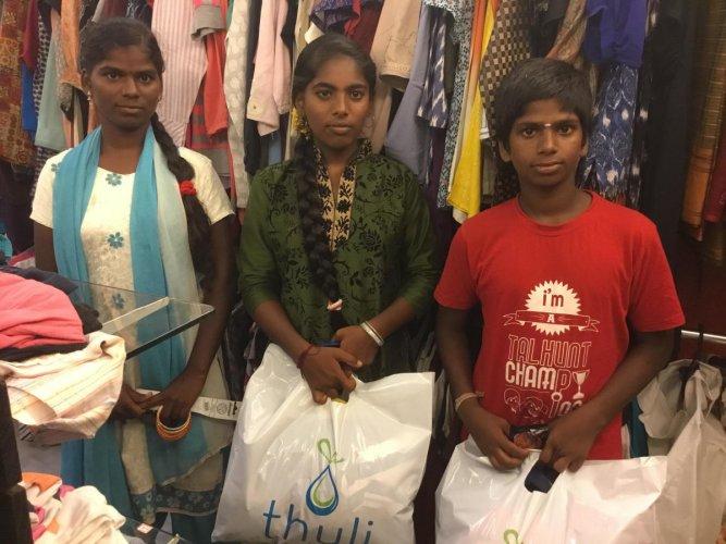 Malathi, Arulmozhi and Balaji, all from lower income class, shop at Thuli in Chennai.