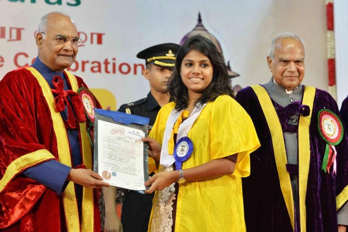 President Ram Nath Kovind presents a certificate during the post-centenary Diamond Jubilee convocation of University of Madras in Chennai on Saturday. PTI Photo