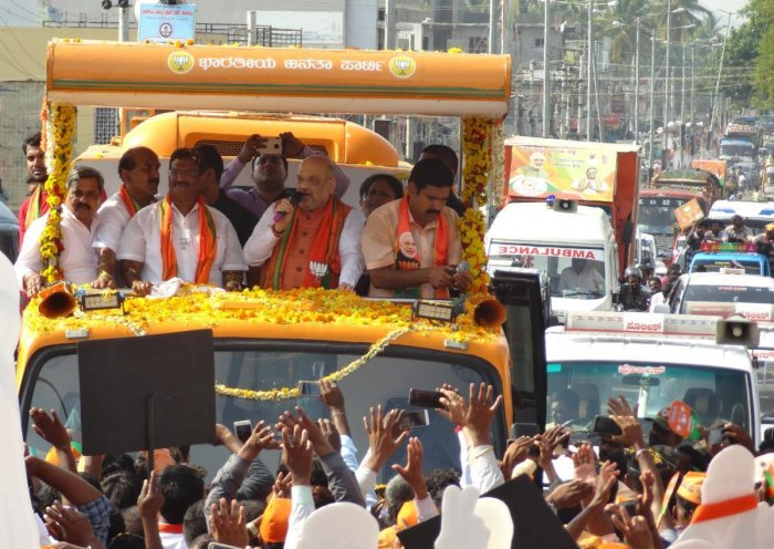BJP president Amit Shah takes out road show in T Narasipur town, Mysuru, on Saturday.
