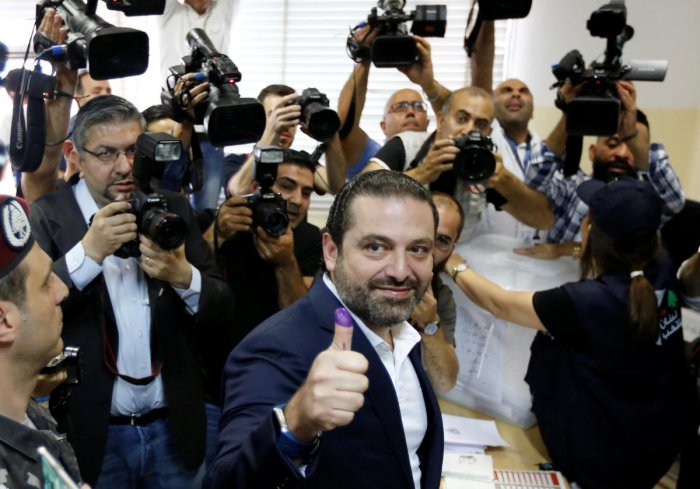 Lebanese prime minister and candidate for the parliamentary election Saad al-Hariri shows his ink-stained finger after casting his vote in Beirut, Lebanon. REUTERS