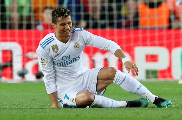 WINCING IN PAIN Real Madrid will hope Cristiano Ronaldo can recover from a knock he received against Barcelona on Sunday. REUTERS