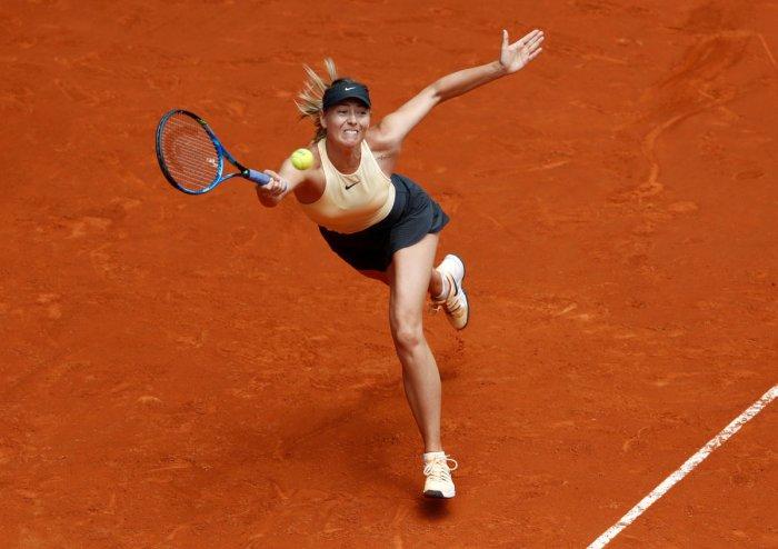 GAINING MOMENTUM Russia's Maria Sharapova returns during her win over Romania's Irina-Camelia Begu on Monday. REUTERS