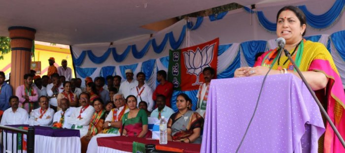 Union Minister for Textiles and Information and Broadcasting Smriti Irani speaks during the BJP campaign in Somvarpet on Monday.