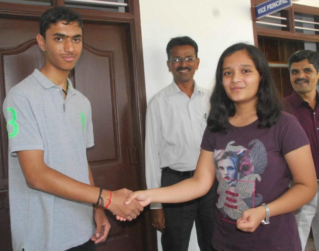 B Hima and Kaveriappa of Vijaya English Medium school, greet each other in Hassan on Monday. dh photo