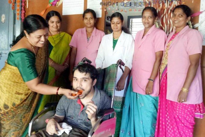 Endosulfan victim Abhishek B V celebrating SSLC result with his mother Gangarathna at Endosulfan Day Care Centre in Koila on Monday.
