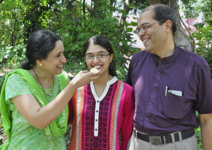Medha top scorer in Udupi district celebrating her success with her parents Shashikala Bhat and Dr Narasimha Bhat.
