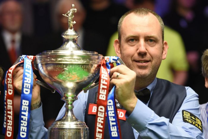 Wales's Mark Williams celebrates with the trophy after beating Scotland's John Higgins in the World Championship Snooker final in Sheffield, England, on Monday. AFP