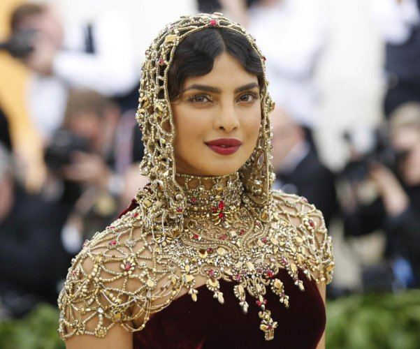 "Priyanka Chopra arrives at Met Gala to celebrate the opening of ""Heavenly Bodies: Fashion and the Catholic Imagination"". Reuters Photo"