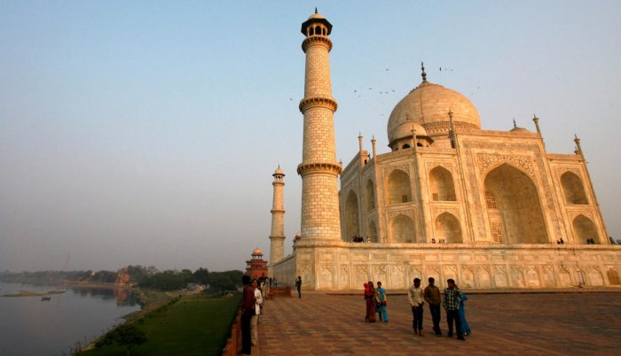 Tourists walk in front of the historic Taj Mahal, Agra. REUTERS Photo