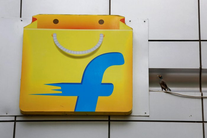 FILE PHOTO: A Common myna sits next to the logo of India's ecommerce firm Flipkart installed on the company's office in Bengaluru. REUTERS