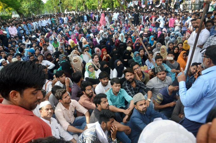Aligarh Muslim University students stage a protest in campus over Jinnah portrait issue. PTI