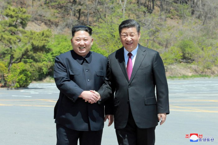 North Korean leader Kim Jong Un shakes hands with China's President Xi Jinping, in Dalian, China. Reuters Photo