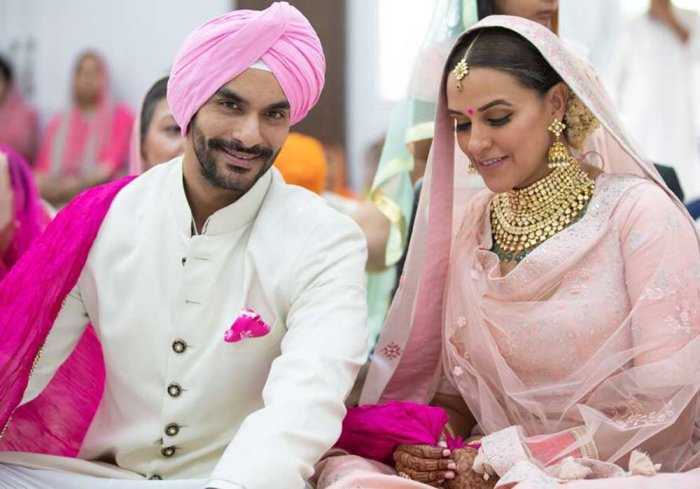 Dhupia shared the news with a picture from the marriage ceremony on her Instagram and Twitter accounts.