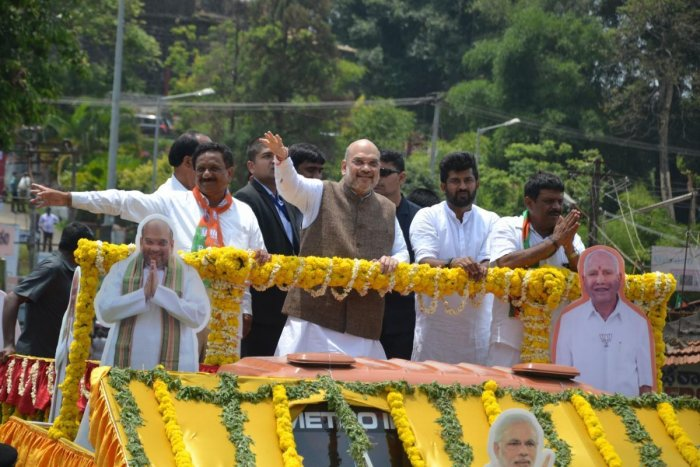 BJP National President Amit Shah took along with BJP candidates from Kodagu M P Appachu Ranjan and K G Bopaiah take out a road show, in Madikeri on Tuesday.