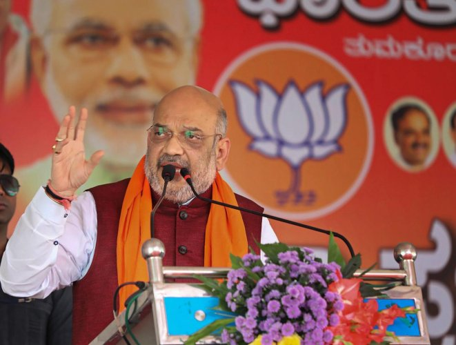 The BJP would win at least 130 seats in the 224-member assembly and there was no need to take any party's support, Amit Shah claimed. PTI Photo