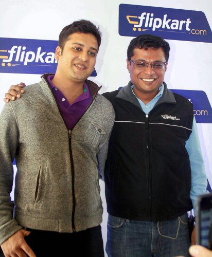 In this file photo dated July 29, 2014, flipkart.com founders Sachin Bansal (R) and Binny Bansal at a press conference in Bengaluru. US retailer Walmart on Wednesday acquired 77% stake in Flipkart for $16 billion. PTI