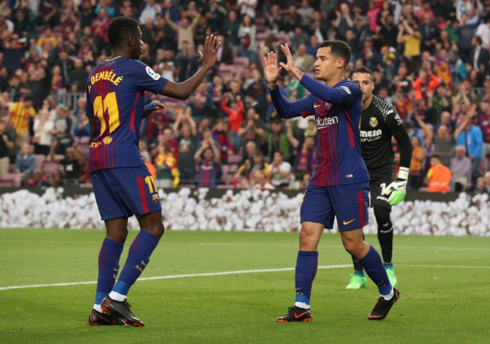 Barcelona's Philippe Coutinho celebrates with team-mate Ousmane Dembele after scoring against Villarreal on Wednesday. REUTERS