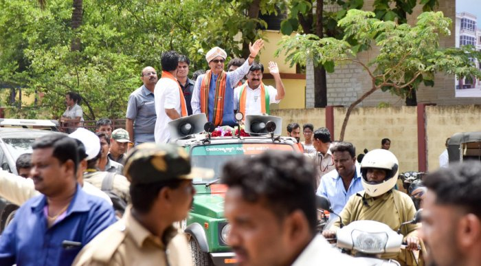 BJP candidate of KR Assembly Constituency S A Ramadas along with Madhya Pradesh CM Shivraj Singh Chouhan, MP Pratap Simha and others taking part in road show during campaigning, at Vidyaranyapura in Mysuru on Wednesday. -Photo by Savitha. B R
