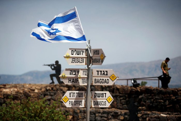 An Israeli soldier stands next to signs pointing out distances to different cities, on Mount Bental, an observation post in the Israeli-occupied Golan Heights that overlooks the Syrian side of the Quneitra crossing, Israel. REUTERS Photo