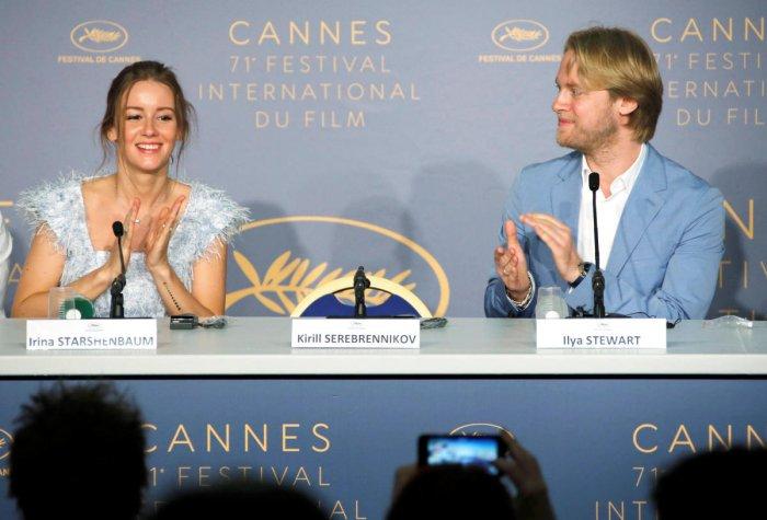 Actor Irina Starshenbaum, director Kirill Serebrennikov's empty seat and producer Ilya Stewart. REUTERS Photo