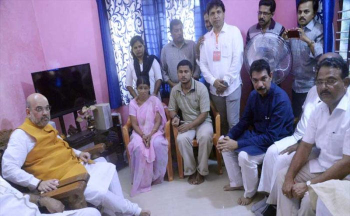 BJP national president Amit Shah, seen here visiting the home of murdered BJP activist Katipalla Deepak Rao. DH file photo.