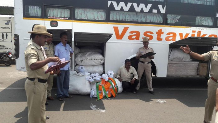 The caps and shalyas of worth Rs 4.5 lakh belonging to Mahila Empowerment Party and Bharatiya Janata Party respectively that were seized by the police at Nippani. DH file photo