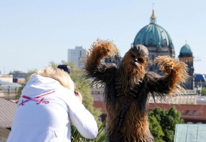 "A person dressed up as Chewbacca character poses during a photocall to promote the new Star Wars Movie ""Solo: A Star Wars Story"" in Berlin. REUTERS Photo"