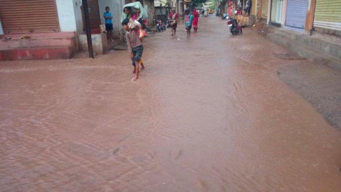 Rainwater overflows on a street in Kamatagi villageof Bagalkot district on Friday.